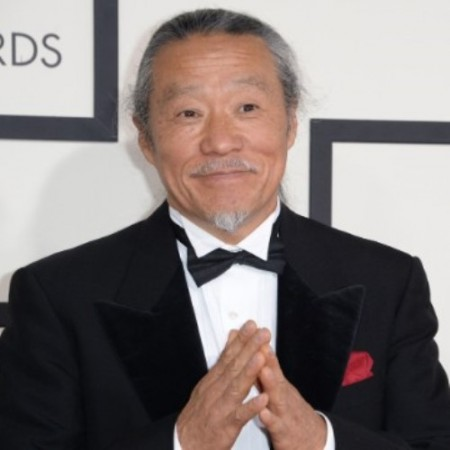 Kitaro arrives on the red carpet for the 56th Grammy Awards at the Staples Center in Los Angeles, California, January 26, 2014. AFP PHOTO ROBYN BECK        (Photo credit should read ROBYN BECK/AFP/Getty Images)